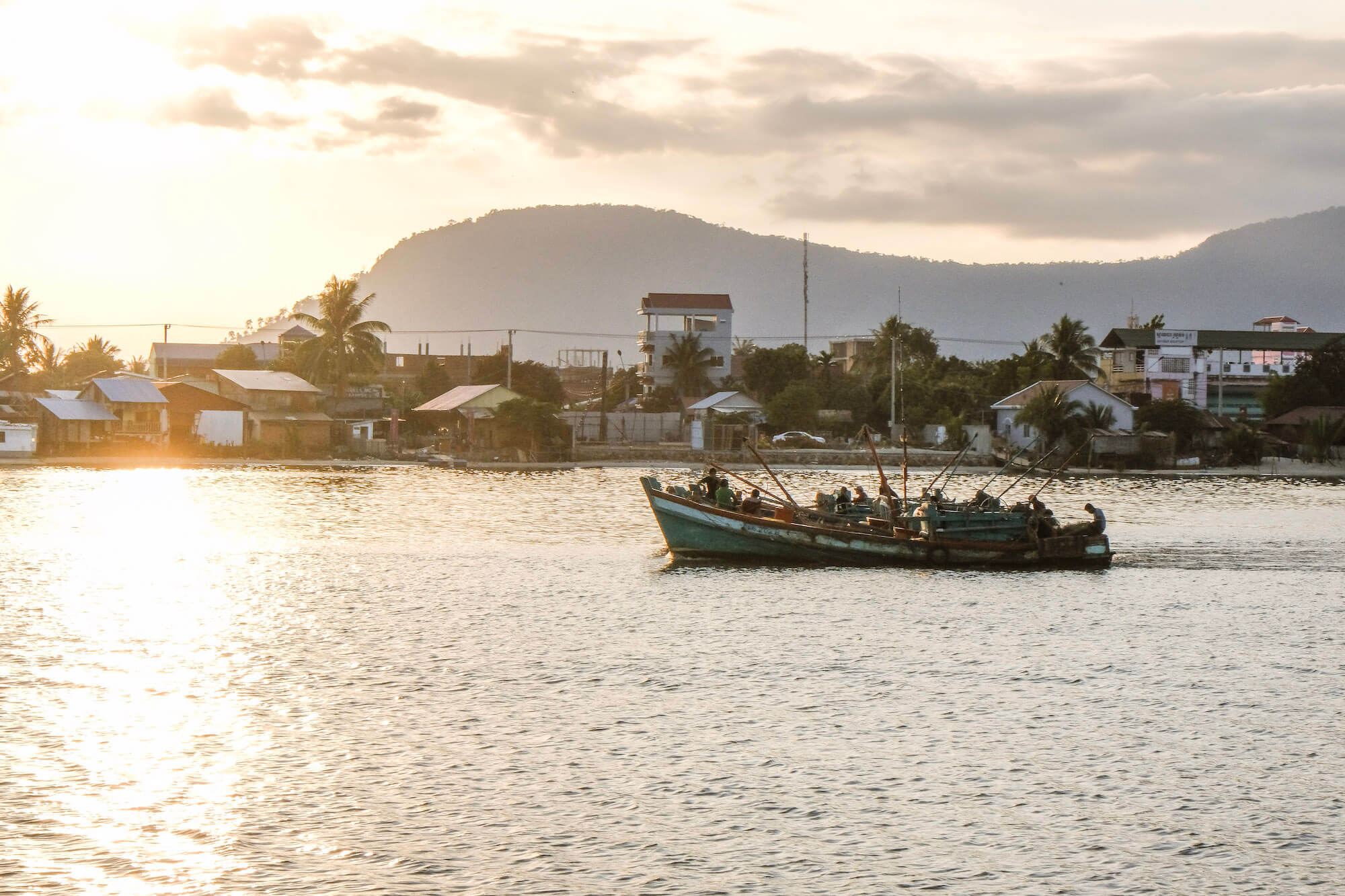 Sunset boat on river in Kampot