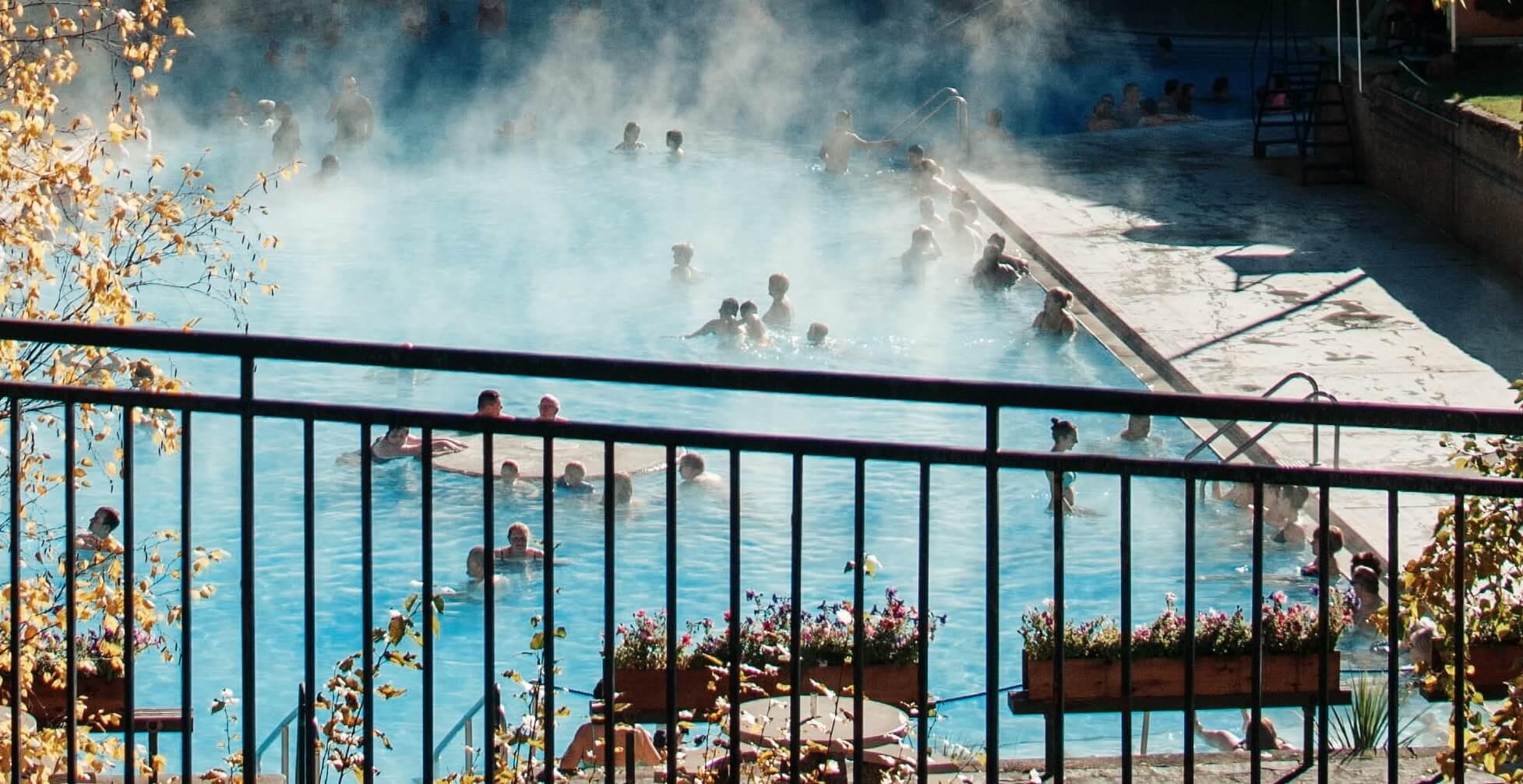 People soak in hot springs