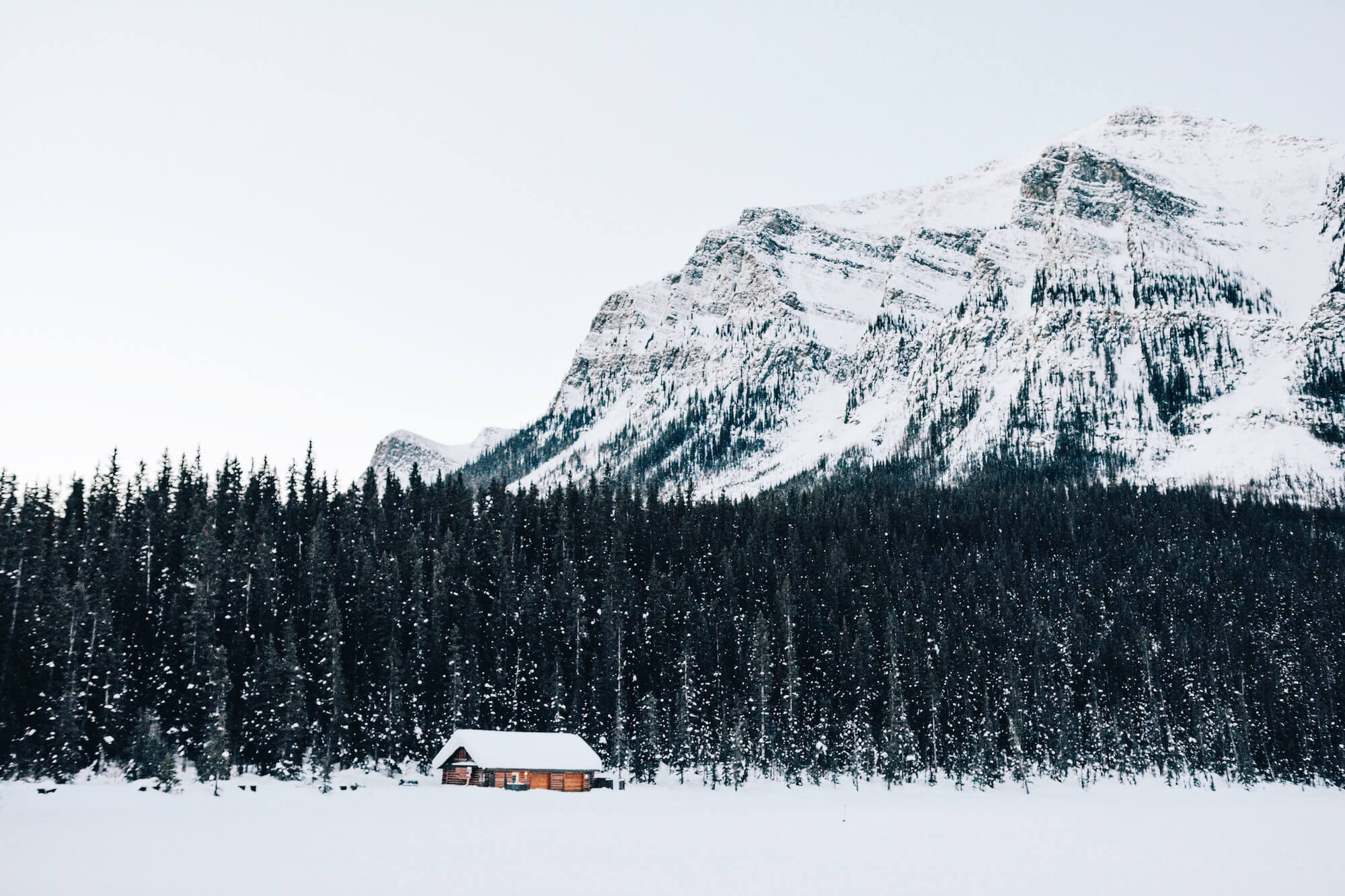 Solo cabin with snowy mountain behind