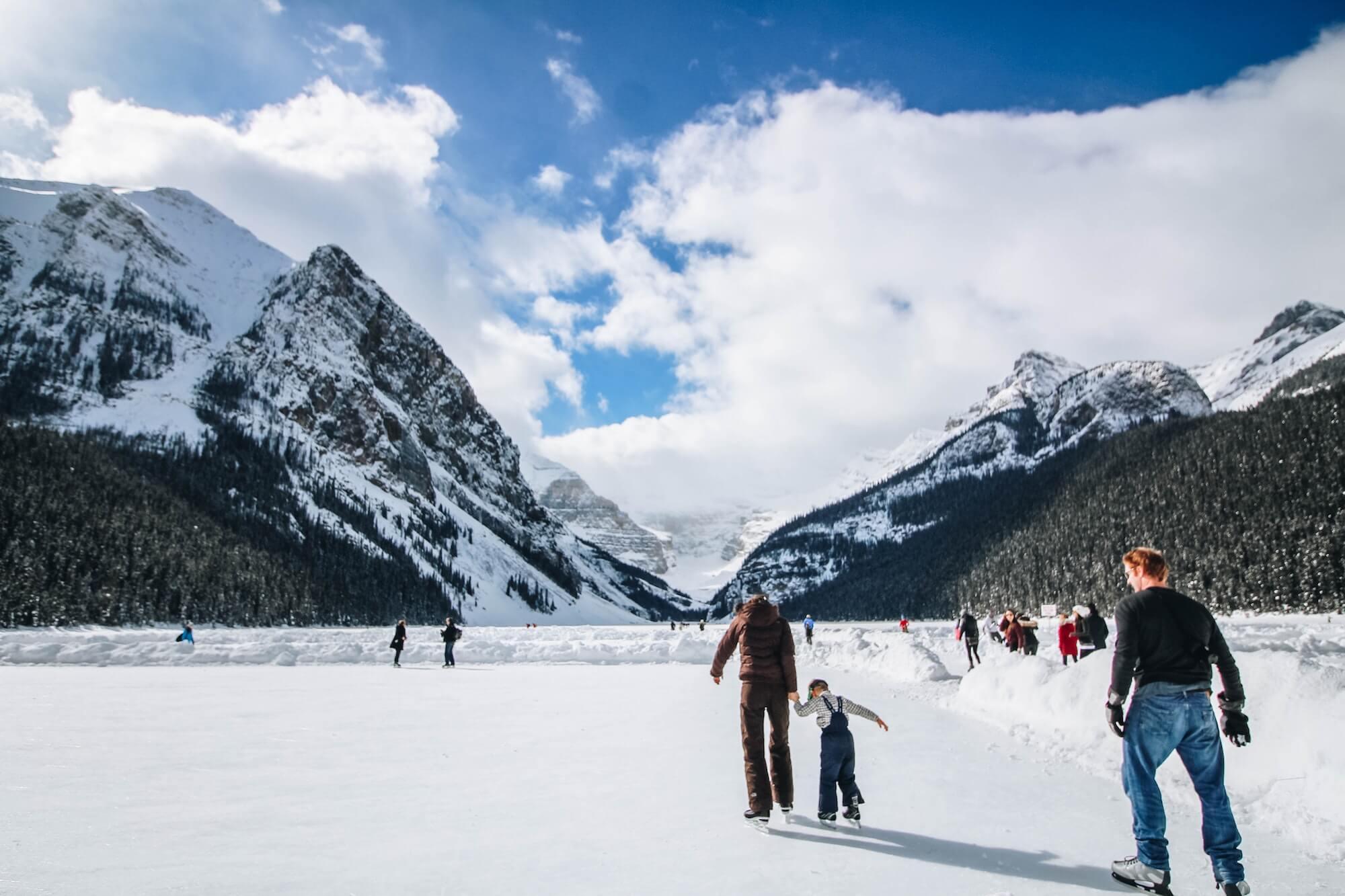 Family skates on frozen Lake Louise