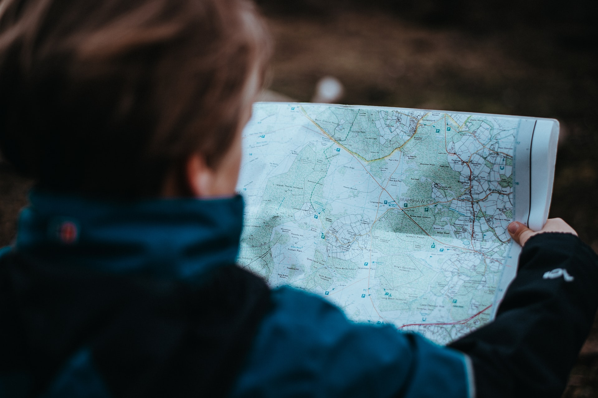 Person looks at map for planning backpacking trip